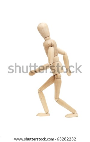 Wooden figure running isolated on white