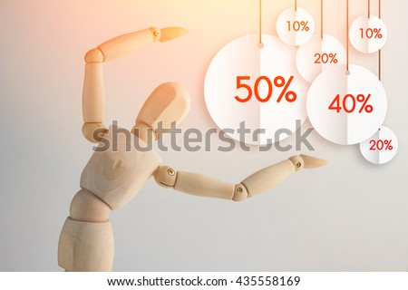 Wooden figure showing up flat tag discount discount promotion concept, copy space for your text - stock photo