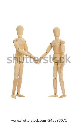 Wooden figures shake hands - stock photo