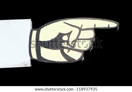 wooden finger pointing sign with black background - stock photo