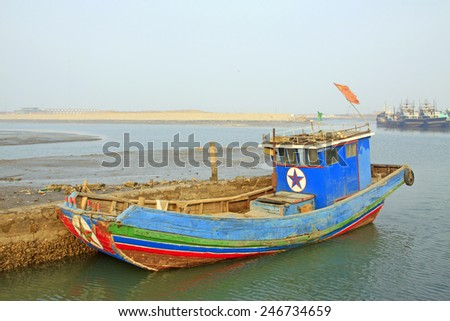 wooden fishing boat port wharf berthing, closeup of photo