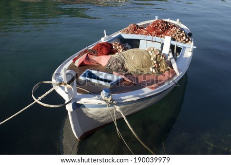 Wooden fishing boat with nets - stock photo