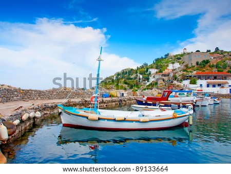 Wooden fishing boats in the beautiful small harbour Kamini of Hydra island in Saronikos gulf in Greece - stock photo