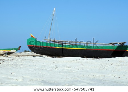 Wooden fishing boats pulled up on the beach at a fishing village near Morondova, Madagascar