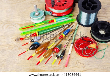 Wooden floats and fishing gear. - stock photo