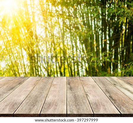 Wooden floor and bamboo  bokeh on sunlight for background