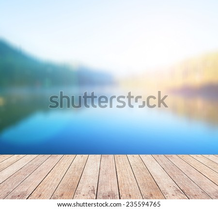Wooden floor and blurred beautiful river on morning background. Pang-ung lake in Mae hong son,Thailand. International Mountain Day, World Water, Ecology, Ecosystem, Environment, Health Care concept. - stock photo