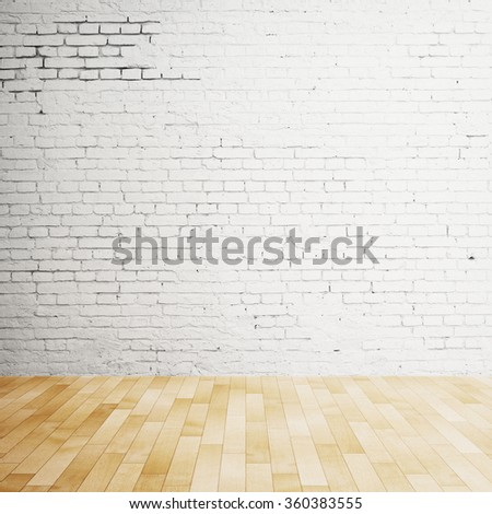wooden floor and brick wall in loft - stock photo
