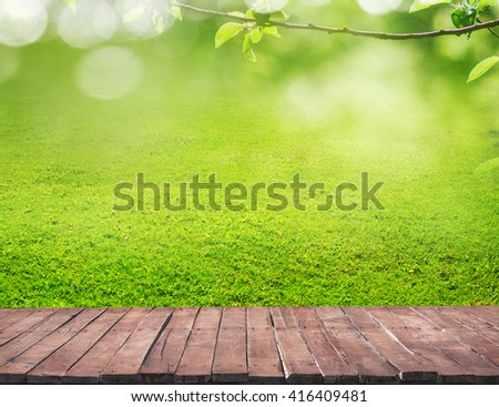 wooden floor and grass - stock photo