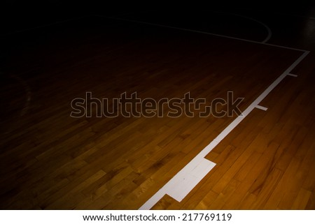 wooden floor basketball court with light effect - stock photo