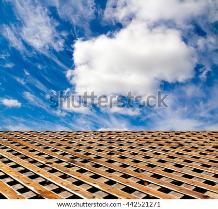 wooden floor blue sky with clouds