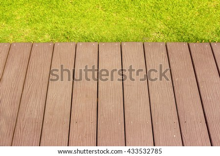 Wooden floor, green grass on sunlight for background, Beauty natural and sunlight background - stock photo