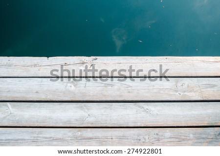 Wooden floor on the pier - stock photo