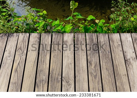 Wooden floor over the river - stock photo