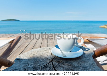 Wooden floor with chaise-longues and coffee