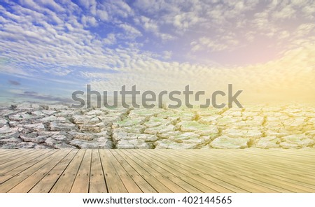 wooden floor with dry soil.Process in vintage color tone. - stock photo
