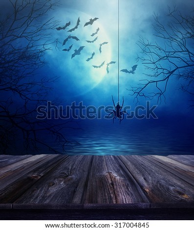 Wooden floor with spider and spooky Halloween background