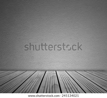 Wooden floorboards and blank wall - stock photo