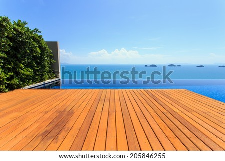 Wooden flooring beside the pool - stock photo