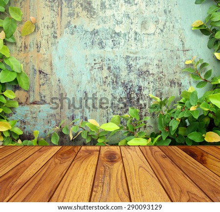 Wooden floors and walls framed leaf - stock photo