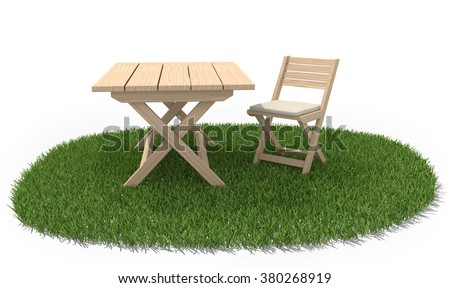 Wooden folding table and chair on green grass lawn.