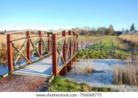 Wooden footbridge in a park at the swedish island Oland