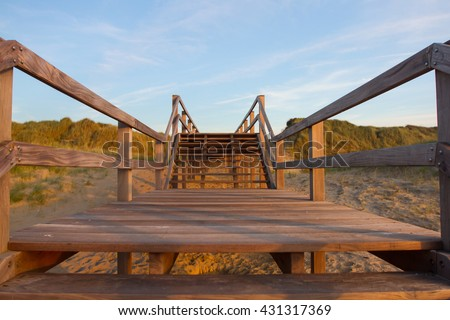 Wooden footbridge on a beach in Belgium
