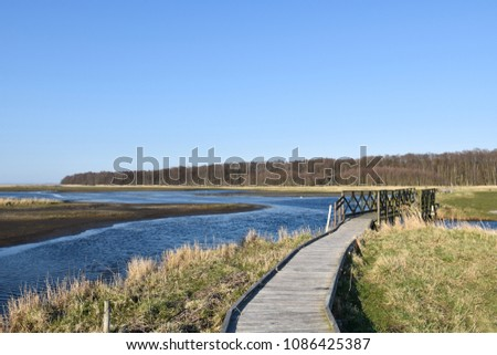 Wooden footpath through the wetland Beijershamn on the swedish island Oland - a famous birding site