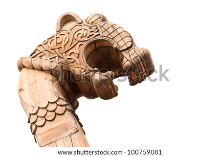 Wooden forepart of the ancient Viking ship isolated on white