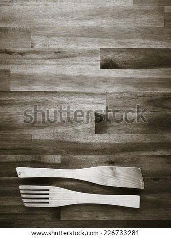 Wooden fork and spatula on the table - tinted black and white image - stock photo