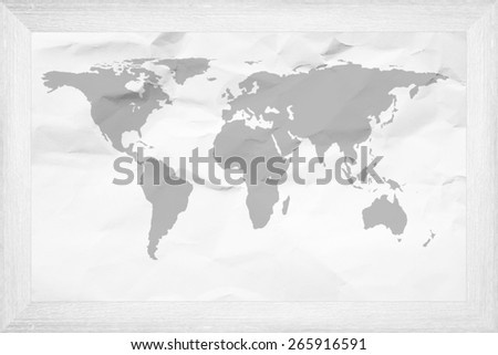 Wooden frame and crumpled paper the world map. - stock photo