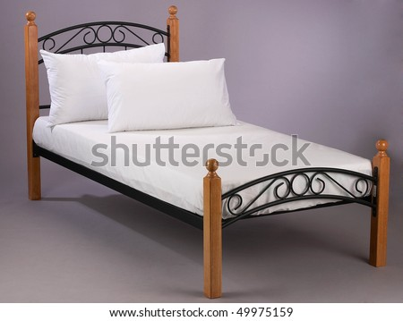 wooden frame bed with white bed sheet