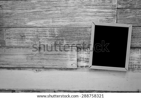 wooden frame hanging on a wooden board.