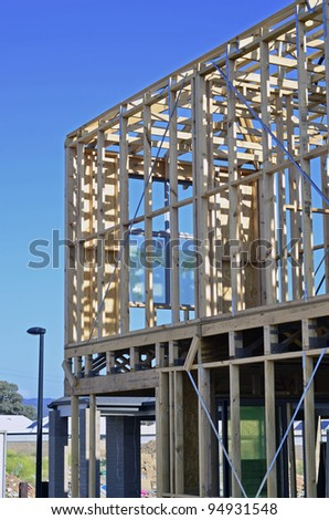 Wooden frame of house under construction - stock photo