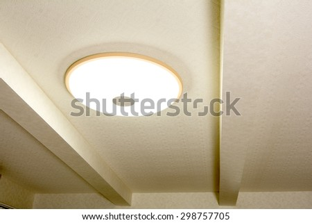 Wooden frame of LED light fixed to the ceiling
