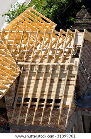wooden frame of new roof - stock photo