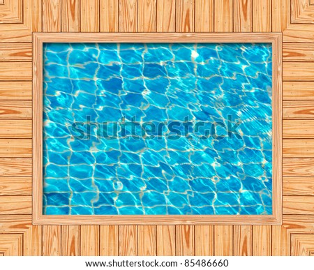 Wooden frame of the blue swimming pool - stock photo