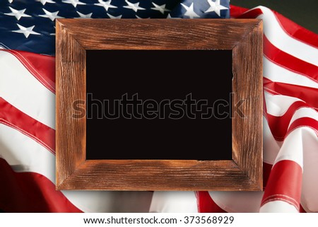 Wooden frame on American flag background - stock photo