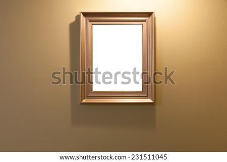 Wooden frame on lighting wall with isolated area - stock photo
