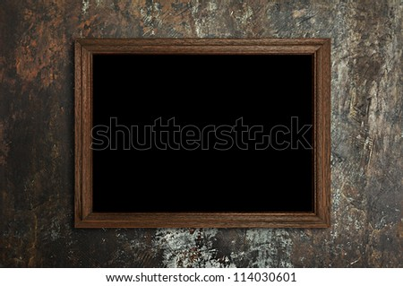 Wooden frame on stained concrete background - stock photo