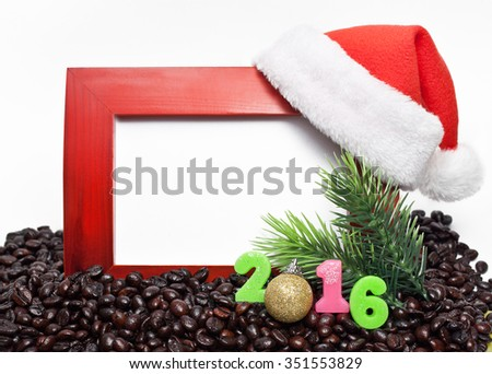 Wooden frame with red new year's cap figures and the 2016 is in coffee beans on white background - stock photo