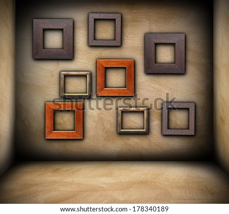 wooden frames on grungy wall of empty room, backdrop - stock photo