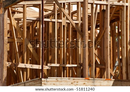 Wooden framing of an unfinished residential building.