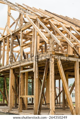 Wooden framing of the new residential house. - stock photo