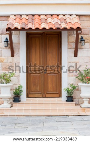 Wooden front door of a home - stock photo