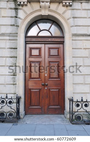 Wooden Front Door of a Luxurious Town House - stock photo