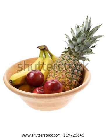 wooden fruit bowl with a pineapple bananas and apples isolated on white background - stock photo