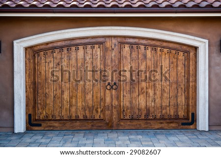 Wooden garage doors on an upscale California home - stock photo