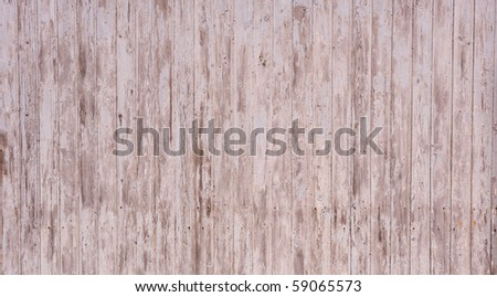 Wooden garage wall with flaked paint and rusty nails - stock photo