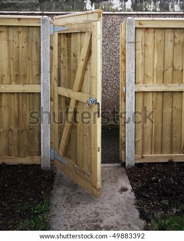 Wooden garden gate and fence - stock photo